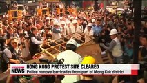 Police clear out protest site in Hong Kong