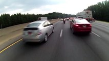 Careless motorcyclist crashes while lane splitting
