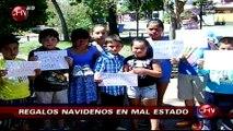 Grupo de niños de escuela de fútbol recibieron como regalo zapatillas en mal estado