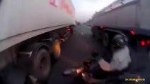 Biker Fall Between Two Trucks | lucky accident, biker lucky accident, biker escape in accident