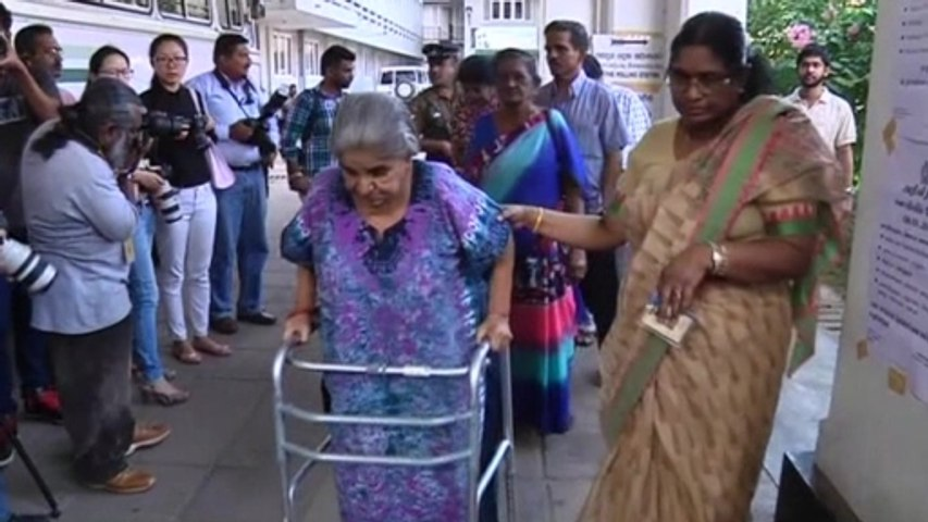 Voters cast ballots Sri Lanka's presidential election.