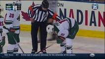 Hockey player Zach Parise Takes Puck To Mouth In Edmonton