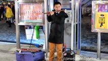 Hong Kong Street Musician Plays the Chinese Flute. Traditional Instrument