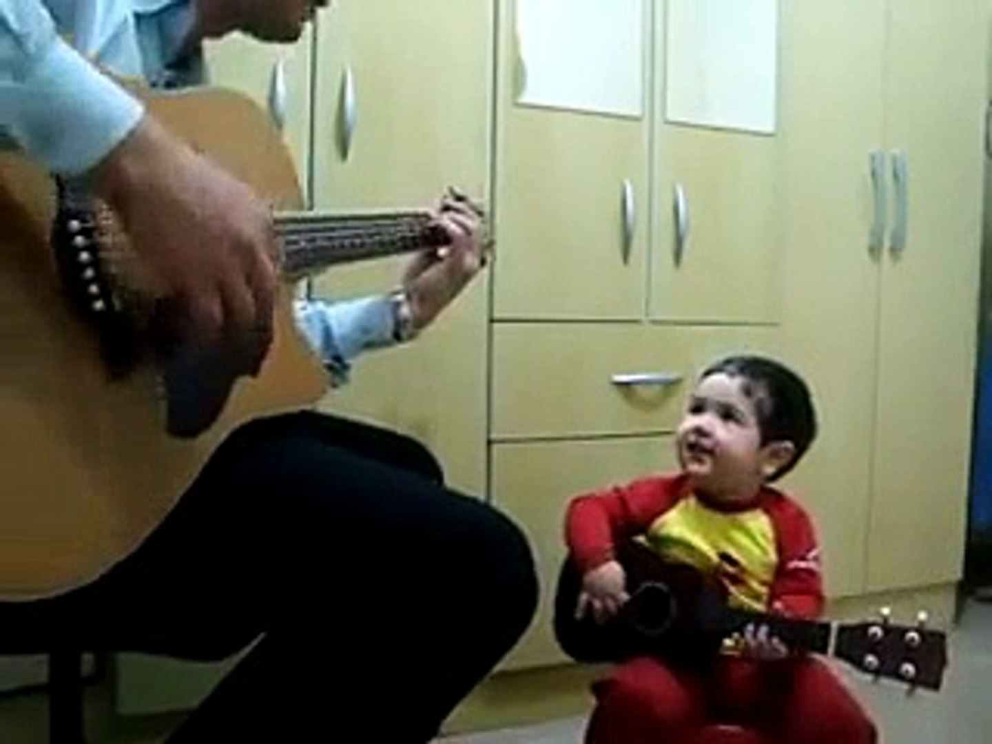 Amazing! Young Kid playing guitar