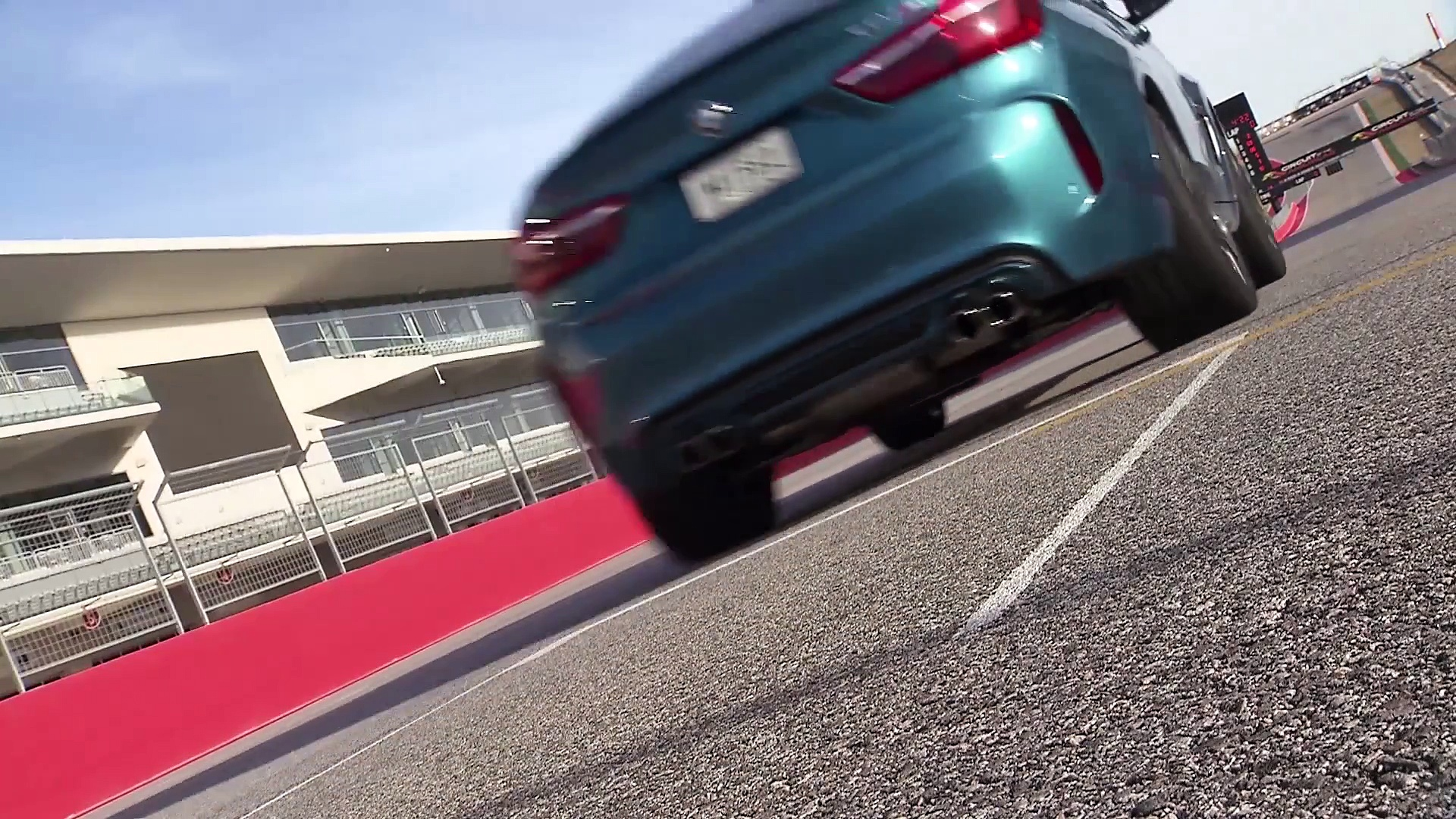 The new BMW X6 M Driving on the race track in Austin Trailer