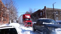 Ford F150 SUV Tows a giant Semi Truck During Chicago Blizzard! Impressive