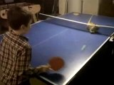 funny cat plays ping pong