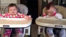 Twins babies singing with her mother.