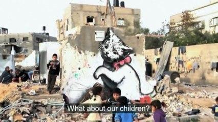 Banksy paints graffiti on remains of Gaza home