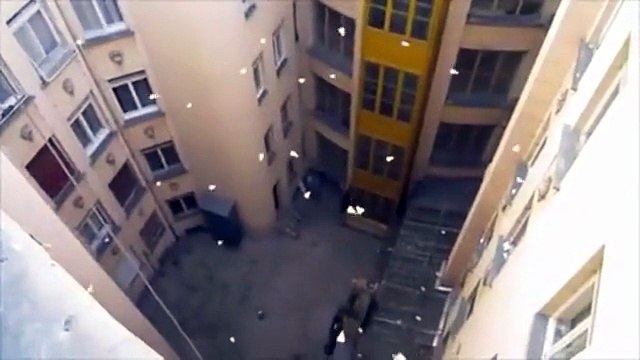 Throwing bucket of paper plane out of a building look pretty cool