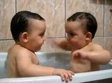 Twins Brothers Enjoying Bath Time -