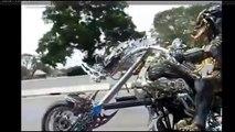 Guy dressed like the Predator cruising down the highway on his custom bike