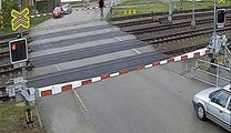 Pensioner hit by train on level crossing and walks away