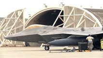 F22 Raptor is Preparing to Take Off with External Fuel Tanks
