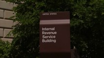 MoneyWatch: Federal employees owe billions in back taxes; Google hires woman CFO