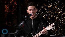 Nick Jonas Delivers Alcohol, Crashes Party and Sings and Drinks With Fans