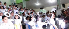 Easter Sunday 2014. The 'Angel Choir' in their finale song at St Isidore Parish Church in Medina,Mis.Or.,Philippines.