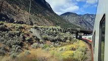 $10 STOCK - Train Travel Past Mountains & Freight (3 Clips)