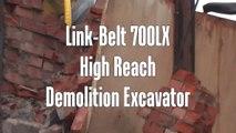 Link-Belt 700LX high reach demolition excavator pulling down clock tower.