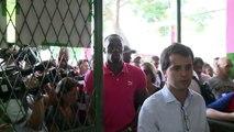 Usain Bolt tours Rio favela sports area