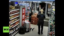 CCTV Knife-wielding robber gets tasered by police