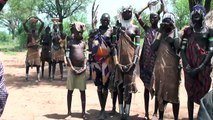 Mursi people - native African tribes in the Omo valley in South of Ethiopia