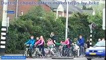 School trips by bicycle. An everyday occurrence in Assen, Netherlands. True mass cycling
