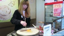 London Street Food. China Style Pancake with Eggs seen in Chinatown