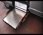 Underfloor wheelchair lifts for car campers bus. To lifts disabled person on vehicle