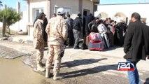 Des Egyptiens fuient la Libye par milliers