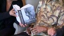 Nelson Mandela receiving copy of Conversations with Myself.avi