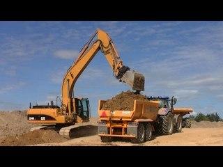 Cat 324D Excavator Loading John Deere,  New Holland Tractors and Hydrema Dumper