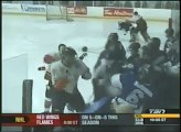 Crazy junior hockey fight, player dove over opponent bench