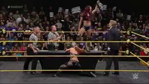 Sasha Banks and Becky Lynch sign the contract for their match at TakeOver WWE NXT, May11, 2015