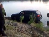 Russian idiot attempting to get a Porsche Cayenne out of the mud