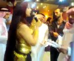 arab man showers belly dancer with money
