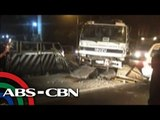 Cement mixer hits concrete barrier in QC