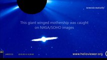UFO Disney NASA Images Giant Winged UFO Passes Past Earth's Sun In SOHO