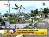 Survivors visit loved ones in Leyte mass graves