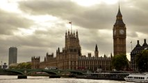 Distant view of Westminster palace, Big Ben, and Westminster bridge, located in London, England.