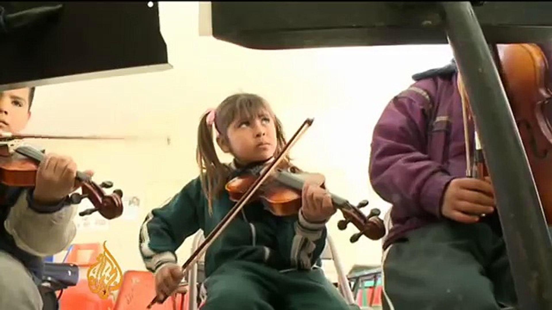 Uplifting kids' lives through music