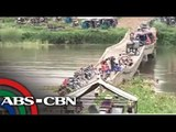 Isabela residents cross damaged bridge