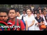 Grace Poe queues, rides MRT sans bodyguards