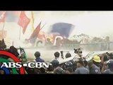 Cops fire water cannons at SONA protesters