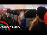 Passengers endure the heat inside the plane