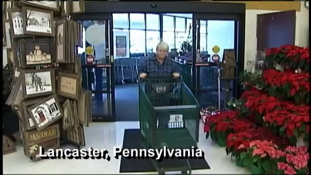 Giant shopping cart takes Chevy engine to move