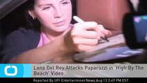 Lana Del Rey Attacks Paparazzi in 'High By The Beach' Video
