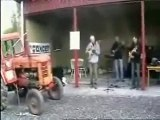 3 guys and a tractor playing music