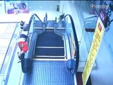 A boy of two years an escalator fall in China