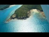 Soaring across the Whitsunday Islands in Queensland by sea plane with Air Whitsunday